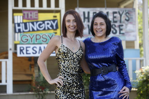 LAURA McKENZIE | New Braunfels Herald-Zeitung Heather Claxton, left, models a gold sequined Betsey Johnson dress while Sara Kapetanis wears a blue sequin outfit at The Hungry Gypsy on Dec. 10.